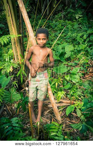 Boy With Stick In Hands