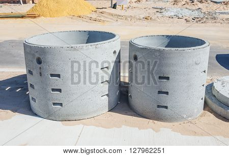 Two concrete soakwells on the construction site before installation