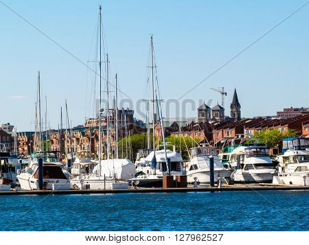 BALTIMORE-APRIL 23 - A view of sailboats in this marina with a city view off in the distance on April 23 2016 in Baltimore Maryland.