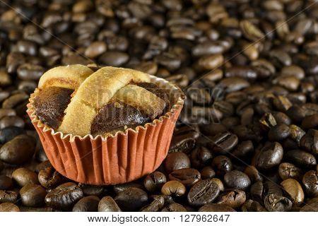 neapolitan pastry dessert on coffee beans background