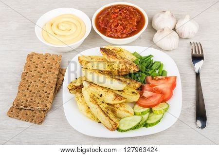 Baked Potatoes With Tomatoes, Cucumbers, Bowl With Ketchup And Mayonnaise
