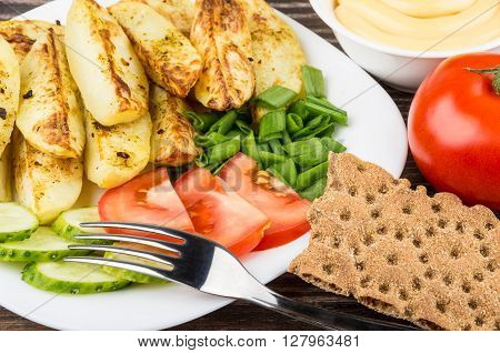 Slices Of Baked Potatoes With Tomatoes, Cucumbers And Leek