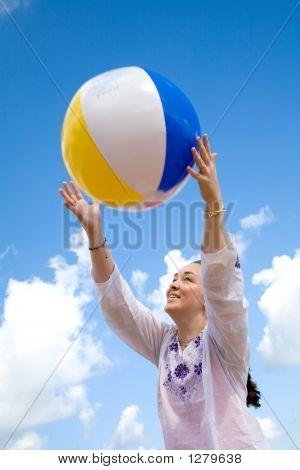 Fun At The Beach With A Beachball