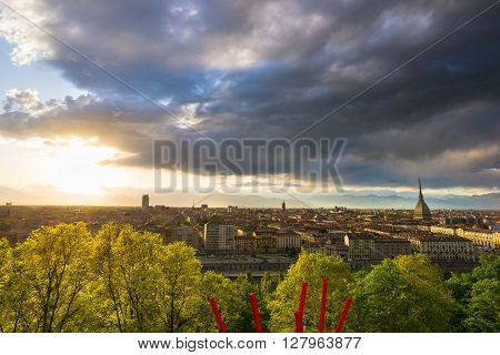 Sunset on Torino (Turin) former capital city of Italy. Panoramic cityscape from above with dramatic colorful sky. Italian historical towns travel destination.