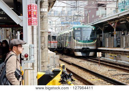 TOKYO - APRIL 1, 2016 : Japanese Train, A commuter train heading towards Tokyo in April 1, 2016 Tokyo, Japan.