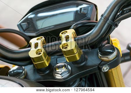 Closeup at the locking handle of the motorcycle.