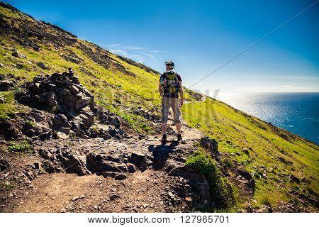 the tourist walking on the trekking path at Ponta de Sao Lourenco Madeira