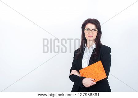 Woman in suit holding tablet in bright orange cover