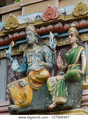 Trichy India - October 15 2013: Detail of facade of short Vimanam at Ranganathar Temple. Tower stands on top of old part built during Madurai Nayak era. Statue of Lord Vishnu and his wife. He holds his discuss and conch.