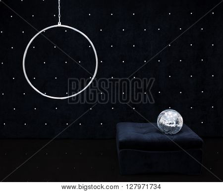 The black area with crystals style feshion with black glossy floor disco ball black pouf hanging ring circus.