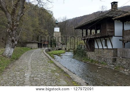 Etar,  Gabrovo, Bulgaria - April 13, 2012: Old traditional houses, old traditional clock tower  and river with bridge in Etar, Gabrovo, Bulgaria. Visit of Gabrovo region in springtime.