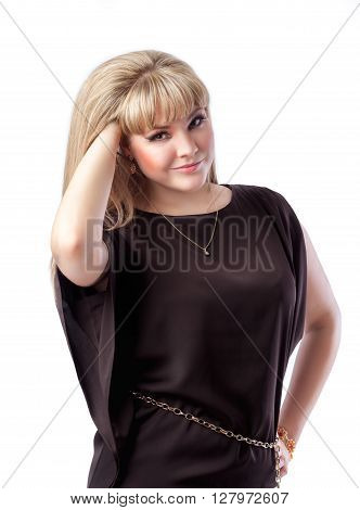 Beautiful blonde girl European appearance straightens hair. Isolated white background.