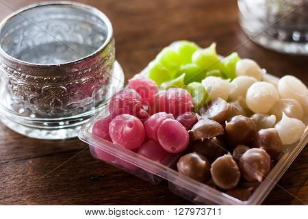 Aalaw candy in plastic tray on wood table