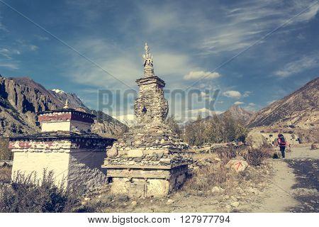 Buddhist stupa along Annapurna trek. Religious stone building.