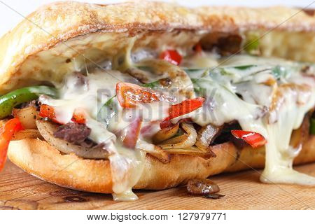 Tasty Beef Steak Sandwich With Onions, Mushroom And Melted Provolone Cheese In A Ciabatta