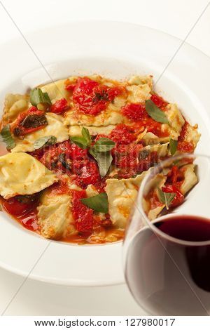 Fresh Homemade Ravioli With Marinara Sauce And Herbs.
