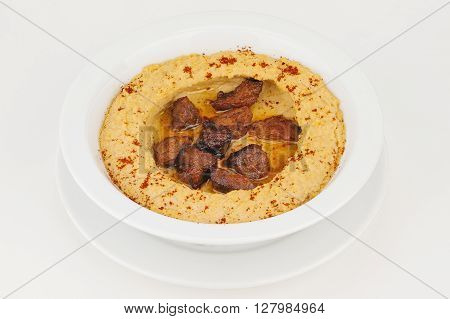 Hummus with braised meat and ground red pepper