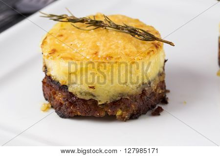 Cottage pie served on white plate. Gourmet food.