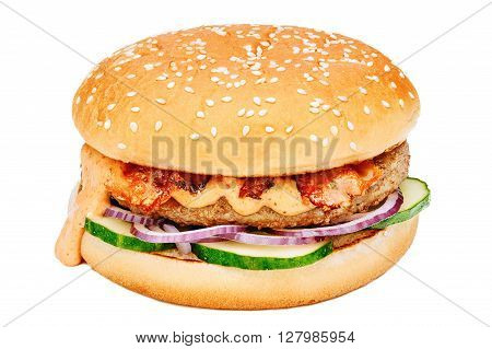 Hamburger sandwich with beef fresh cucumber onion and sauce flowing down one side isolated on white background