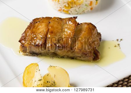 Codfish grilled with rice colored. Gourmet food.
