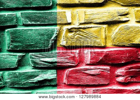 Brick wall Benin flag with some cracks and vintage look