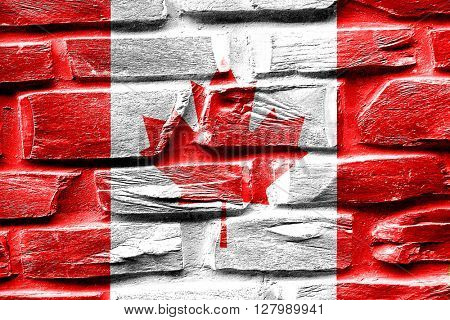 Brick wall Canada flag with some cracks and vintage look