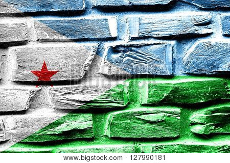 Brick wall Djibouti flag with some cracks and vintage look