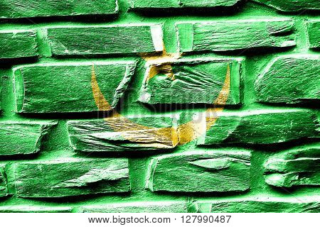 Brick wall Mauritania flag with some cracks and vintage look