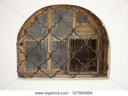 Oldfashioned Semicircular Window in a white wall