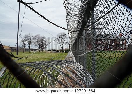 Coils of razor wire are attached to a chain link fence around the perimeter of the Joliet Juvenile Prison in Joliet, Illinois.