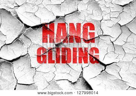 Grunge cracked Hanggliding sign background
