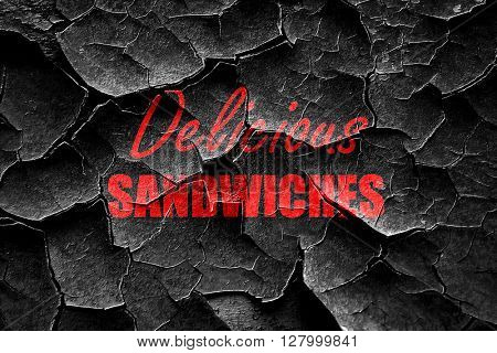 Grunge cracked Delicious sandwich sign