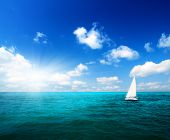 stock photo of sail-boats  - sailboat sky and ocean - JPG