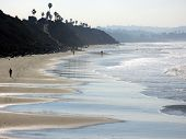 picture of swami  - waves leave wet patterns in beach sand in this southward view from swami - JPG