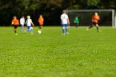 Постер, плакат: Blurred Youth Soccer Players