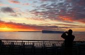 Cruise Ship Tourist Taking Pictures Of Sunset poster