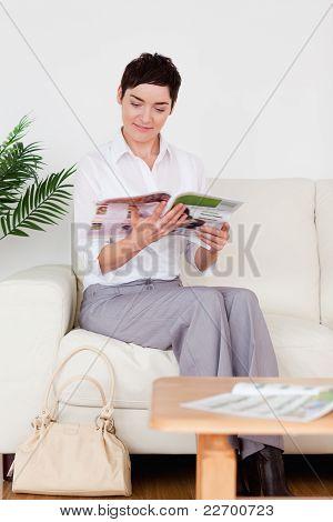 Charming Woman Reading A Magazine