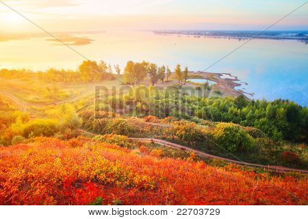 Valley of Kama river (Ural region in Russia) with trees and roads at sunrise