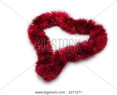 Isolated Christmas Tinsel Decoration Arranged In A Heart Shape