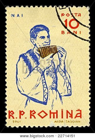 ROMANIA-CIRCA 1961:A stamp printed in ROMANIA shows image of The pan flute or pan pipe  is an ancient musical instrument based on the principle of the closed tube, circa 1961.