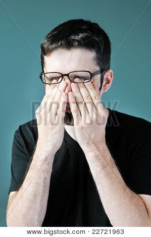 Man Rubbing Eyes