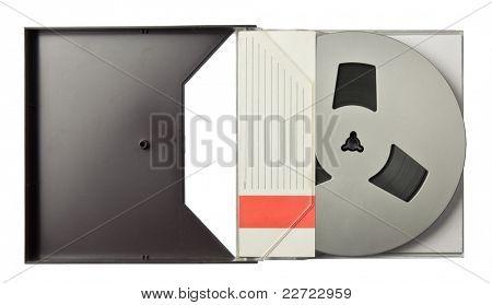 Vintage magnetic audio reel in a blank package.