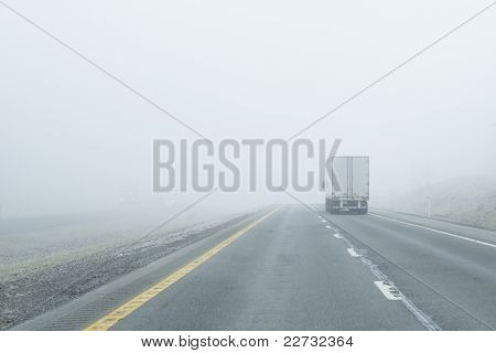 Semi-truck Drives Into Dense Fog