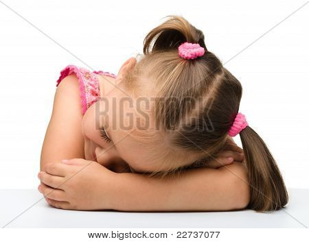 Little Girl Is Sleeping At Table