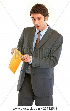 Shocked Modern Businessman Checking Parcel