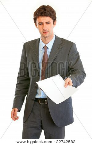 Displeased Modern Businessman Showing Document