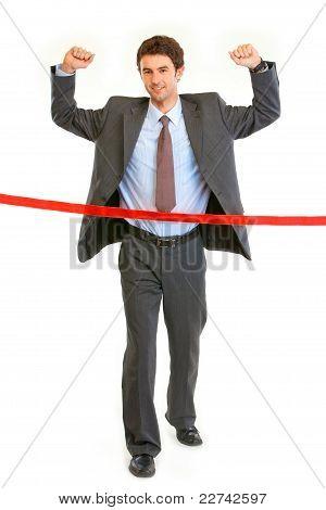 Full Length Portrait Of Pleased Businessman Crossing Finish Line. Concept - Success Achievement