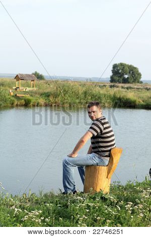 Man Relaxes On The Lakeside