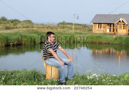 Man Rests On The Lakeside