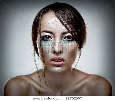 Beauty Head Shot Of A Woman With Heavu Makeup